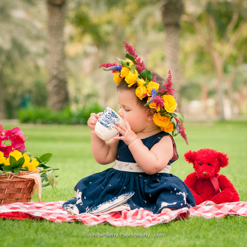 Drinking tea in a flower crown and red teddy bear