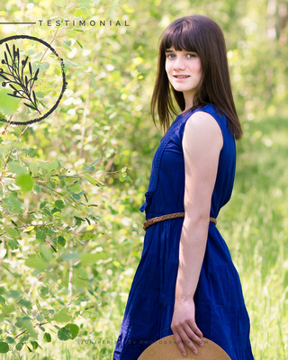 A teenage girl in a blue dress during a portrait photo shoot with Heidi at Juniper Berry Photography