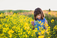 Young girl in a canola field